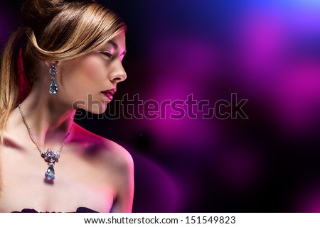Glamour portrait of beautiful fashion model posing in exclusive jewelry. Professional makeup and hairstyle  - stock photo
