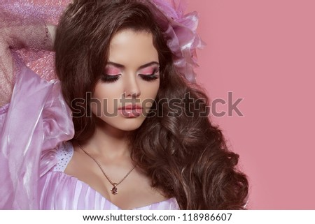 Glamour portrait of beautiful woman model with curly hair and bright make-up. Jewelry - stock photo
