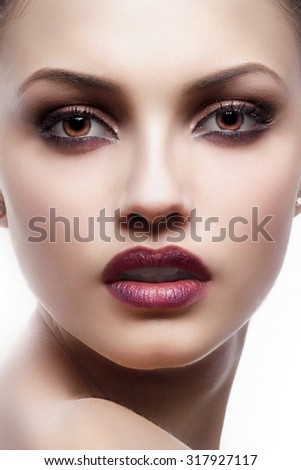 Glamour portrait of beautiful woman model with fresh daily makeup and romantic wavy hairstyle. Fashion shiny highlighter on skin, sexy gloss lips make-up and dark eyebrows - stock photo