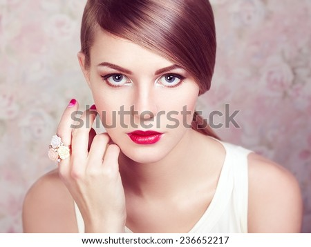 Glamour portrait of beautiful woman model with fresh makeup and romantic  hairstyle. Beauty girl with professional makeup. Jewelry. Fashion photo. - stock photo