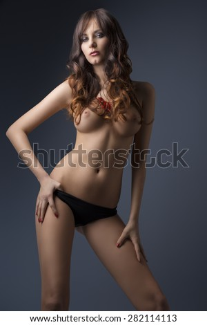 glamour portrait of sexy nude brunette with long hair, naked breast stylish necklace and black panties. perfect body, erotic style - stock photo