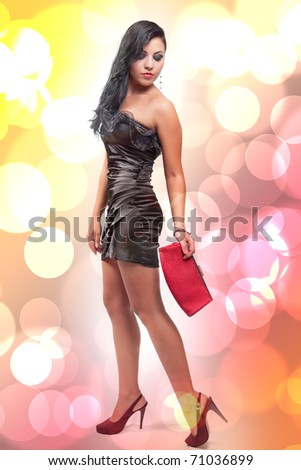 Glamour portrait of sexy young brunette woman - stock photo