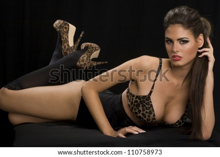 Glamour sensual woman in lingerie on dark background - stock photo