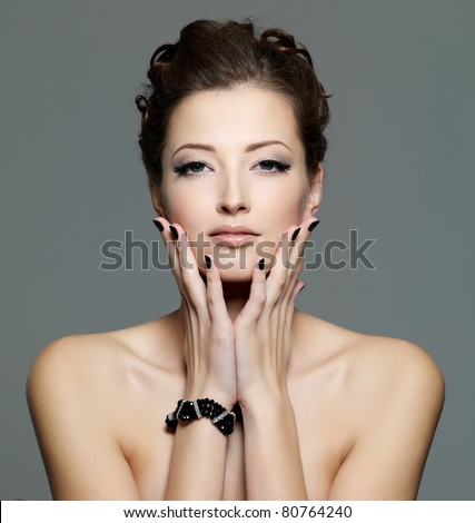 glamour sexy young  female with black nails and  eye make-up. Front portrait - stock photo