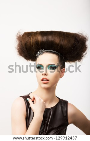 Glamour. Vitality. Portrait of Unusual Brunette with Extraordinary Festive Hair-do - stock photo