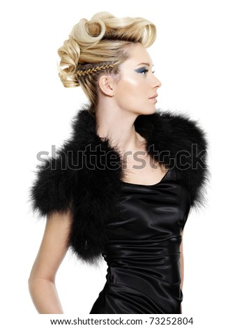 Glamour woman in black fur dress with modern  hairstyle posing   on white background - stock photo