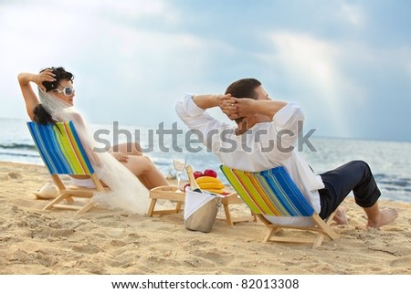 Glamour young couple resting on the beach - stock photo