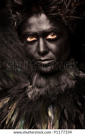 Glare look of harpy - mystical creature, isolated on black - stock photo