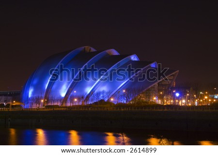 Glasgow's so-called 'Armadillo' building at night time - stock photo