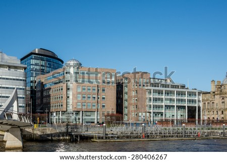 GLASGOW, SCOTLAND - MARCH 08: Modern office buildings on banks of the River Clyde at Atlantic Quay on March 08, 2015 in Glasgow, Scotland. - stock photo