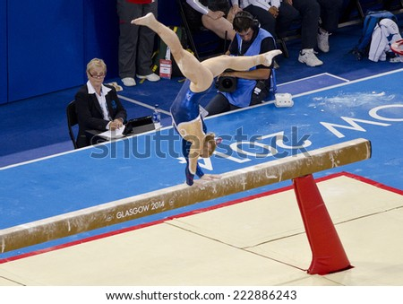 GLASGOW, UNITED KINGDOM - JULY 30: unidentified Scottish gymnast on Beam in Ladies All Around B Final at Commonwealth Games in SSE Hydro on July 30, 2014 in Glasgow, United Kingdom.  - stock photo