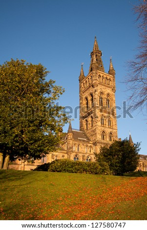 Glasgow University, Kelvingrove, Scotland, bathed in the warm glow of a late afternoon autumn sunset. - stock photo