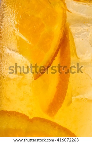 glass abstract background with orange slices - stock photo