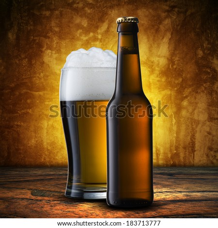 Glass and bottle of beer - stock photo