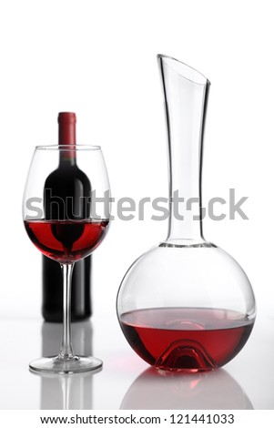 glass and bottle of red wine decanter - stock photo