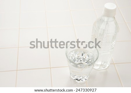 Glass and bottle of water - stock photo