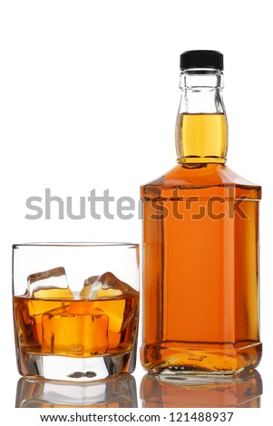 glass and bottle of whiskey on a white background - stock photo