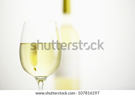 Glass and bottle of white wine - stock photo