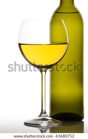 Glass and bottle of white wine on white background. - stock photo