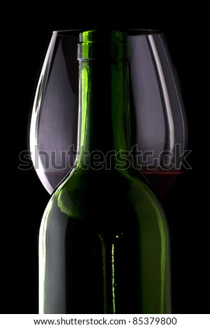 Glass and bottle of wine - stock photo