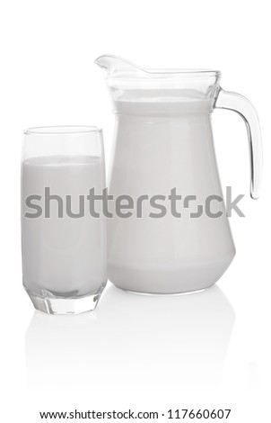 Glass and jug of milk isolated on white background. File contains a path to cut. - stock photo