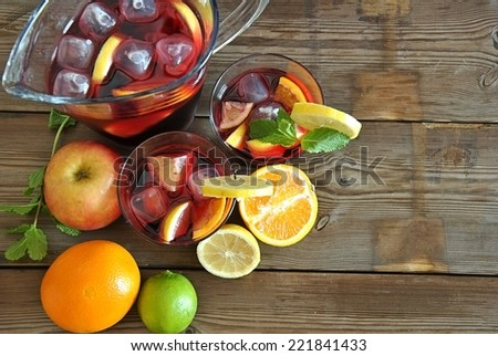 glass and pitcher of ice cold Sangria - stock photo