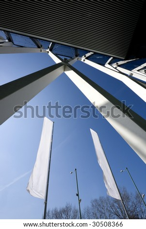 Glass architecture and two flags - stock photo