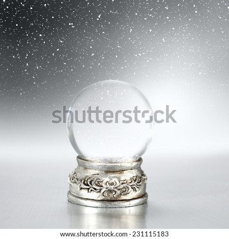 glass ball and snow  - stock photo