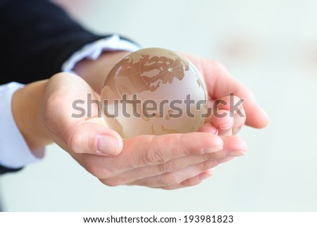 glass ball in the hand - stock photo