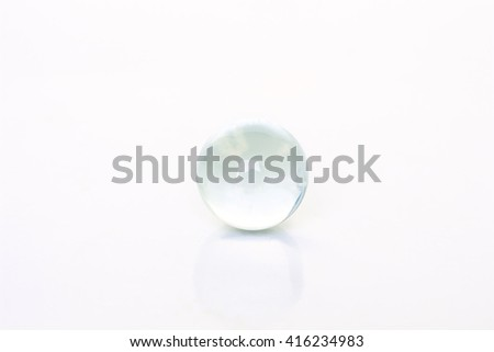 glass ball sphere decoration on white background - stock photo