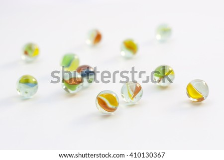 glass ball, sphere shape toy, transparent and colorful - stock photo