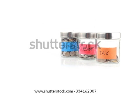 Glass bank for tips with money - stock photo