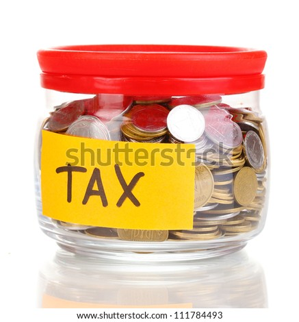Glass bank for tips with money isolated on white - stock photo