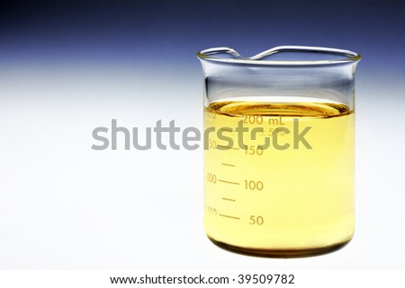 Glass beaker of bio fuel shot on light box with room for copy - stock photo