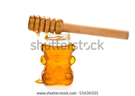 Glass bear with honey inside isolated on a white background - stock photo