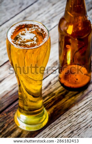 Glass beer and Bottle beer on wood background  - stock photo