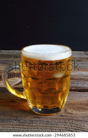 Glass beer on wood background, glass of fresh light beer  - stock photo