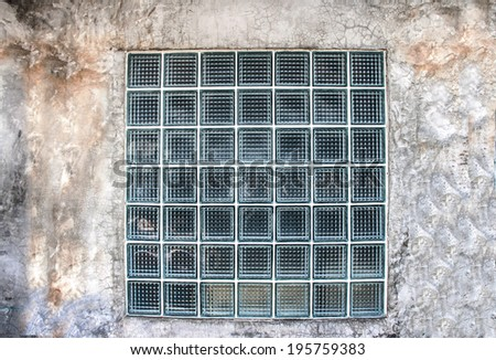 glass block on the old cement wall for construction design - stock photo