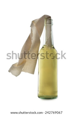 Glass bottle filled with gasoline, a so called Molotov Cocktail, isolated on white background - stock photo