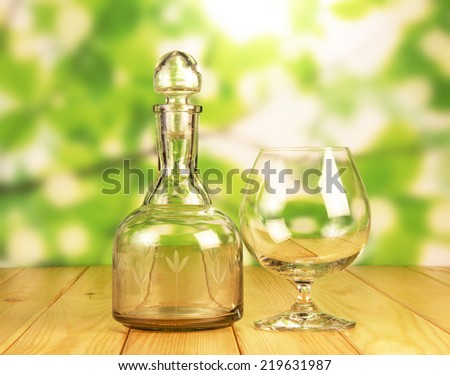 Glass bottle for whiskey and a glass - stock photo