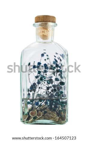 Glass bottle full of herbs as an infusion or air freshener, isolated over white background - stock photo