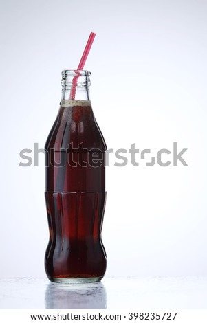glass bottle of cola soda isolated on a white background - stock photo