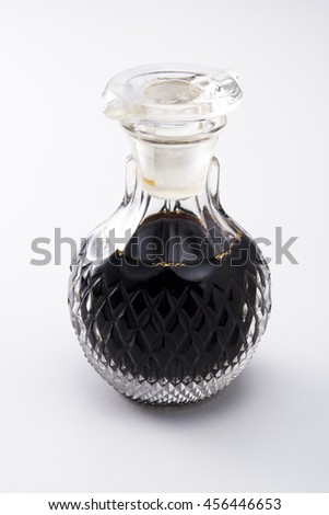 Glass bottle of soy sauce - stock photo