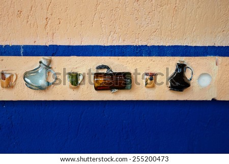 glass bottles on the wall - stock photo