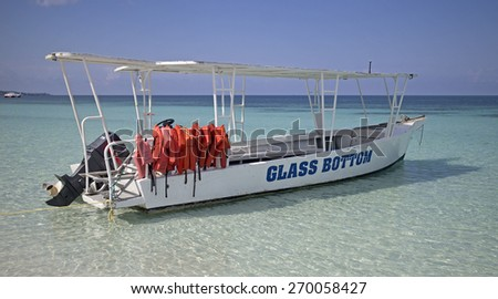 glass bottom boat on caribbean sea - stock photo