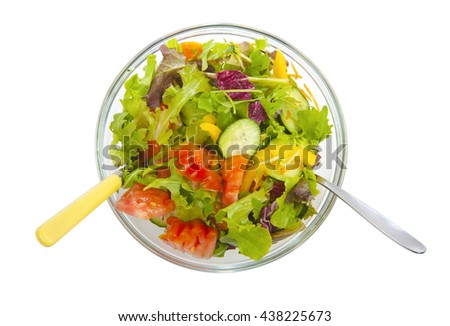 Glass bowl of mixed salad photographed from above - stock photo