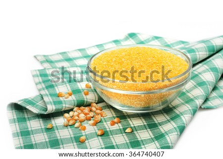 glass bowl with corn grain on a napkin - stock photo
