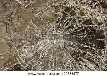 glass broken but held together with security film - stock photo