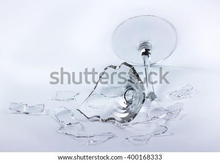glass broken on white back Center focus - stock photo
