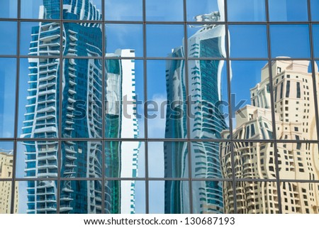 Glass building in Dubai - stock photo